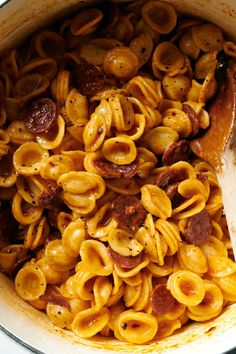 NYT Cooking: Macaroni and chorizo is classic Spanish comfort food. While iterations abound, it typically starts by frying smoked chorizo with a little onion, adding canned or fresh tomato and maybe some oregano, then letting it simmer into a thick tomato sauce. It's often topped with cheese and baked like a mac and cheese. Instead of fresh tomatoes, this recipe uses highly concentrated tomato paste, which i... Pot Pasta, Pasta Dishes, Mozzarella, Chorizo Pasta, Pasta Recipes, Cooking Recipes, Roasted Root Vegetables, Spicy Sauce, Popular Recipes