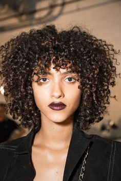 The sparkling, chocolatey lip at DKNY's spring 2017 show has to be one of our favorite looks, like, ever. Find out 9 beauty secrets we discovered backstage at NYFW!