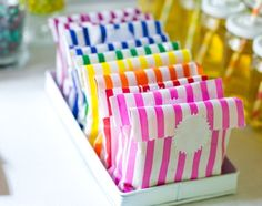 Love these striped paper bags with white starburst sticker labels for a carnival party or rainbow party