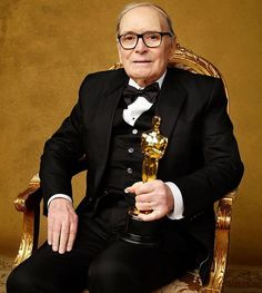 "Ennio Morricone posing with his Oscar for Original Score of ""The Hateful Eight""."