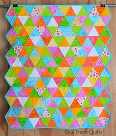 Equilateral Triangle Quilt with description of how she quilted it so nicely and with link to the binding tutorial for doing inside corners | Sew Fresh Quilts