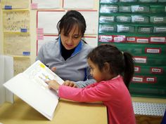 Paola Garcia reads a book with her three-year-old daughter Emily at Action for Boston Community Development's (ABCD) Head Start program in the Roslindale neighborhood of Boston, Massachusetts March 5, 2013. According to ABCD, 95 percent of the money for the Head Start program comes from the federal government, funding that faces cuts under sequestration. (Photo by Brian Snyder/Reuters)