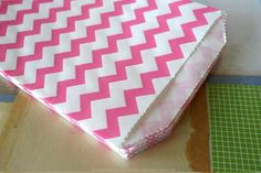 """Cute Thin Stripe Chevron Pattern Paper Favor BagsBitty in size... Big on uses- Treat bags - Favor bags at weddings, showers or birthday parties - Scrapbooking - Product packaging - Gift wrapping - Outer wrap for A2 cards or invitations - Organize small paper scraps, ribbon, stickers, etc. 5 x 7.5"""" White Kraft paper Food Safe Semi-opaque Bio-degradable Recyclable Made in the USA $5.50"""