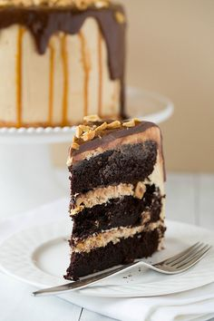 Snickers Cake Recipe ~ A cake reminiscent of a Snickers bar - chocolate cake with a peanut nougat filling, covered in a salted caramel buttercream and topped with a milk chocolate ganache and chopped peanuts