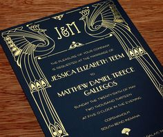 Stunning gold foil pops on the black paper of this art deco wedding invitation.