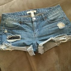 Forever 21 distressed shorts Size 27. Worn couple times. Cute shorts but too big on me.  It can be rolled up or down. Forever 21 Shorts Jean Shorts