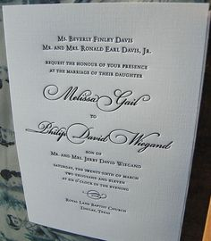 This traditional wedding invitation was designed with a formal