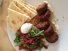 Mezze breakfast plate Falafel, pita, hummus, condiments and a poached egg. Courtesy of 'hawk and hunter'