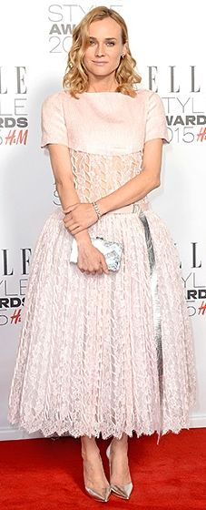 Kruger rocked a feminine Chanel Couture dress with an unlined midriff and full, midi-length skirt. The actress paired the bold dress with an Edie Parker clutch.