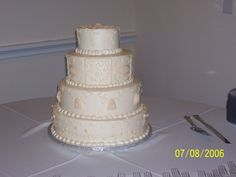 Victorian - Ivory buttercream with rolled buttercream floral designs.