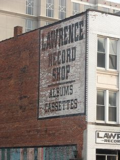 Urban Advertising and Art 000031 - faded painted sign in black and white over brickwork for the Lawrence Record Shop - Broadway, Nashville, Tennessee