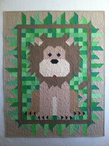 This adorable lion is perfect for a baby's nursery!  Pattern: Regal Patch by Quiltmaker Pieced and Quilted by: Rachel @ Quiltineering
