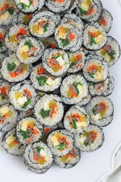 I actually prefer Maangchi's YouTube video instructions and her gimbap recipe more, but I like the techniques this link offers on rolling the gim! Yum!