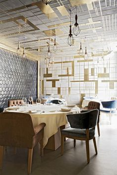 drop brass grid ceiling and screening wall.