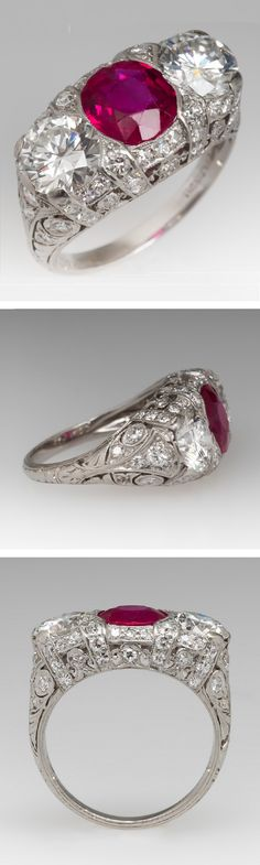 An Art Deco platinum, diamond and ruby ring. This magnificent Art Deco ruby ring features a diamond encrusted filigree mounting set with a vibrant and amazing ruby and two lively round brilliant diamonds.