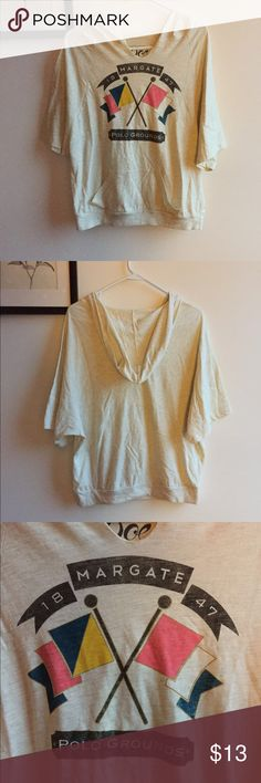 polo grounds poncho t-shirt Nautical t-shirt that fits like a poncho. Size medium with a big pocket on the bottom of shirt and hood on the back. Cream/oatmeal color. Good condition! Doe  Tops Tees - Short Sleeve