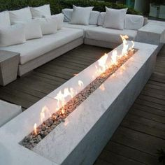 Minimalist extra-long fireplace for outdoor heating. It feels as good as it looks!