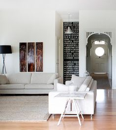 I like the framing of the entry hall.  I like the insert of text into the small space, reminds me of Sallys paintchips wall.  Don't like all the clean.