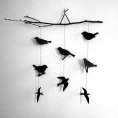 Ooo...i like the black :)      Bird and Branch Mobile. The original creator made it from wood, but if you're not into drilling and painting, I think a reasonable facsimilie could easily be made from paper by tracing bird shapes on thick cardstock.