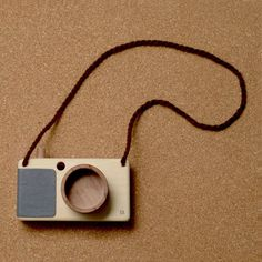 Fanny & Alexander camera made of Guatambu and Incense wood with leather grip and zoom feature. Fanny And Alexander, Old Fashioned Toys, Wood Projects For Kids, Toy Camera, Woodworking For Kids, Wood Necklace, Kids Corner, Vintage Cameras, Photo On Wood