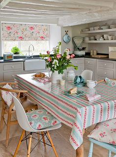The Clarke and Clarke fabric in this kitchen is beautiful. It looks like a pretty cottage kitchen with lots of pretty textiles and sewing project inspiration