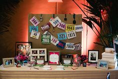 Cute way to personalize a wedding -- string running numbers as decor at the guest book table.  Photo by Manus Chau Photography.