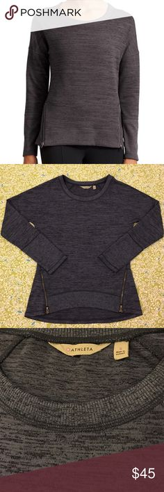 "Athleta Blissful Sharkbite Sweatshirt Favorite Sporty Techie Sweatshirt with a high-low hem and front zips for mobility. ▫️Color: Shale Heather ▫️Exaggerated crew neck for extra breathing Room ▫️Raglan sleeves give you room to move ▫️Rib-knit trim along cuffs and hem ▫️High-low hem for coverage, two forward-placed side zips for extra mobility ▫️18"" Pit to Pit ▫️26"" Length ▫️Excellent Condition  Happy Poshing! 🛍👗👚👠 Ships Next Day 📦 Smoke-Free Home 🚬 Pet-Free Home 🐶🐱 Athleta Sweaters"