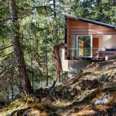 BattersbyHowat Architects Inc designs a quiet home tucked away in the woods of Gambier Island, British Columbia, Canada.