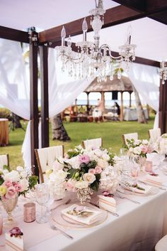 Pink rose wedding table decor: Floral Design: Flowergirls - http://flowergirlshawaii.com Groom's Attire: Tommy Hilfiger - http://www.stylemepretty.com/portfolio/tommy-hilfiger-3 Wedding Dress: Pronovias - http://www.stylemepretty.com/portfolio/pronovias-7 Read More on SMP: http://www.stylemepretty.com/destination-weddings/2017/04/03/destination-wedding-full-of-elegance-tradition/