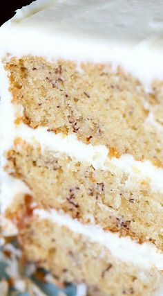 The Best Banana Cake Recipe Ever ~ It's soft, sweet with the perfect amount of banana and it's topped with creamy frosting!
