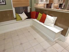 HOW TO BUILD A BANQUETTE STORAGE BENCH: A built-in banquette is a great option for adding extra storage and seating.