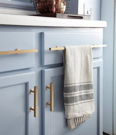 Brushed Brass Cabinet Pulls Against Light Blue Cabinets--would pop even more against navy