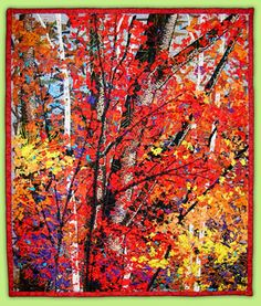 """Fall's Fashion Statement - 19"""" x 21""""  An interpretation of a photograph of an autumn scene. Using quilt artist, Noriko Endo's technique of sandwiching a gazillion minuscule pieces of fabric between layers of black tulle. Art quilt by Lynn Ticotsky"""
