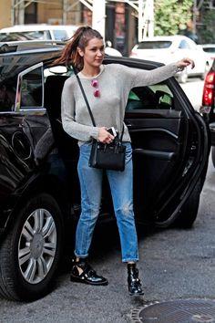 Bella Hadid wearing Balenciaga Ceinture Ankle Boots, Saint Laurent Mini Sac De Jour Bag and Ray-Ban Round Metal-Frame Sunglasses in Brown/Pink