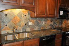 interesting larger tiled kitchen  backsplash