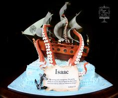 Pirate ship cake modeled after one seen by McGreevy Cakes.  Most decorations were made from modeling chocolate.  Wafer paper sails.
