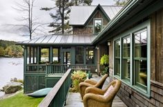 Lake House updated exterior..love the screened in porch..two styles of cedar siding, and roof choice