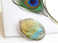 Check out this item in my Etsy shop https://www.etsy.com/uk/listing/545705146/genuine-labradorite-pendant-natural