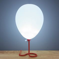 Everybody loves balloons! That's why this mood light is the ultimate gift - it looks just like a floating balloon, anchored to a metal stand that looks like a string. It features phasing LEDs, so it g Floating Balloons, Balloon Lights, String Balloons, Desk Light, Lamp Light, Lampe Ballon, Funky Lighting, Lighting Ideas, Red Table Lamp