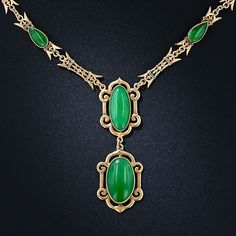 Natural Burmese jadeite oval cabochons accented with a matching pair of smaller pear shape jades and and is clasped with a navette shape jade in this (possibly antique) necklace. The artfully fashioned yellow gold links can be construed as either Asian or neoclassically influenced. This enchanting and unusual necklace dates anywhere between 1900- 1930s.