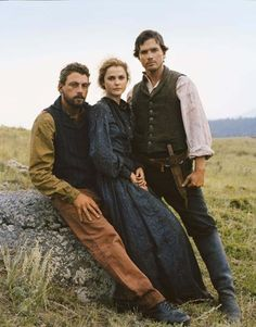 Skeet Ulrich as Jethro Wheeler, Keri Russell as Naomi Wheeler, and Matthew Settle as Jacob Wheeler--Into the West.