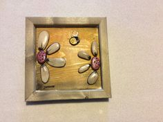 Stone art painted flowers and a bee by StoneArtByJanine on Etsy