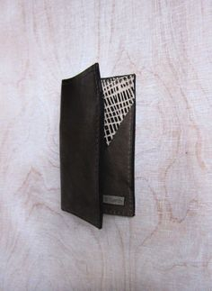 bronze leather card holder with grey bronze and cream-silver suede triangles inside. £12.00, via Etsy.
