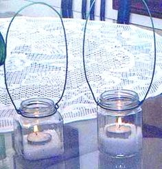 Recycle jars and wire coat hangers to make pretty hanging lanterns for patio or garden.
