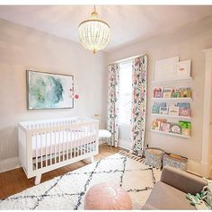 NURSERY / / Love all the natural light on the big rug in this baby's room, and all those books and artwork on the shelving look great, a lovely room to grow up in. ✔️  @thedecorfix via @babyletto