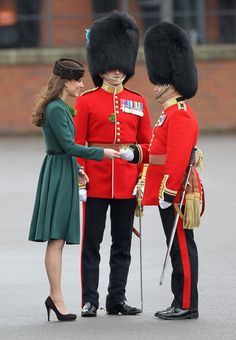 Catherine, Duchess of Cambridge presents 'shamrocks' as she takes part in a St Patrick's Day parade as she visits Aldershot Barracks on St Patrick's Day on March 17, 2012 in Aldershot, England.