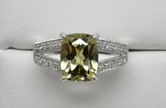 We are so pleased to offer this Natural Zultanite® & Diamond ring set in 14k solid gold. This beautiful ring features a 9x7mm cushion cut Zultanite gemstone that weighs 2.57 carats. Its accented by 46 natural Diamonds that are set across the shoulders and around the basket. The Diamonds have a combined combined weight of .17 cttw. The setting is 14k solid gold. The band measures 8.5mm at the shoulders and tapers down to 2mm along the bottom. This ring weighs 4.85 grams. It comes in a siz...