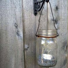 Turn mason jars into luminous lanterns to hang on a fence or from a plant hook | Photo: Courtesy of Pennington Block | thisoldhouse.com