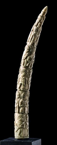 Africa | Figurally carved elephant tusk from the Loango Coast region of DR Congo | Such tusks feature commonplace scenes of contemporary life, especially commercial transactions between whites and blacks. The spiraling pattern has a long history in the Kongo region and could allude to the path that the people believe the dead follow from earth to the ancestral realm and back again to be reborn.