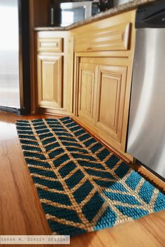 Paint your own Herringbone Chevron Rug - who knew you could paint a rug!  Awesome way to customize it to your home's color scheme :)